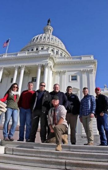 Group standing in front of the Capitol Building in DC.